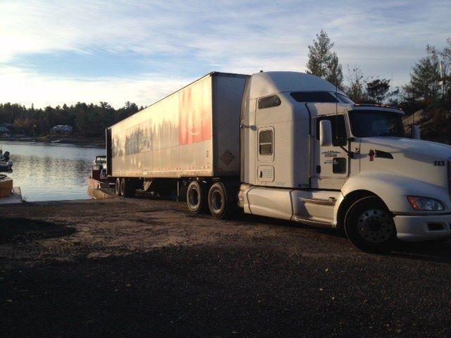Trucking and unloading at a marina